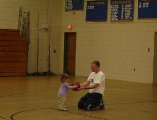 Coach Bugbee with granddaughter Grace, Class of 2025